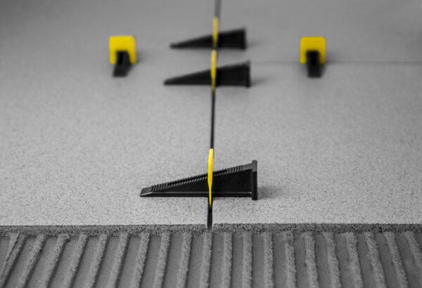 Plaatimistööde tasandussüsteemi kiilud